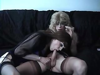 Crossdressers sucking each other
