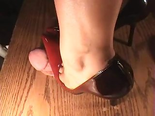 Wife tramples hubby s cock in her heels while on the phone to her sister