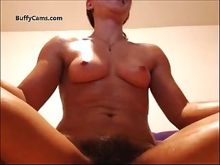 Hairy muscle girl flexing on webcam
