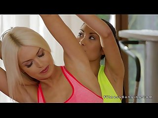 Fit lesbian Asian babe licks blonde Milf in the gym