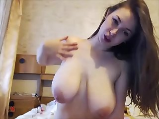 Sexy busty young girl takes off her lingerie undressing her delicious nipples on her bed and..