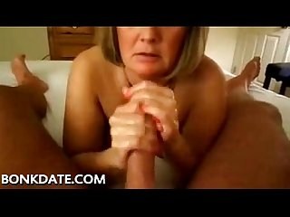 Mature gives handjob and swallows cum