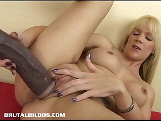 Busty blonde riding a massive brutal dildo