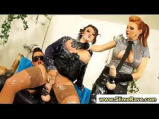 Glamorous lesbos get cumshower in gloryhole from plastic cocks